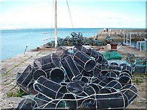 J3829 : Lobster pots on the north wall of Newcastle Harbour by Eric Jones