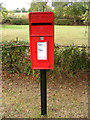 TM4064 : East Green Postbox by Geographer