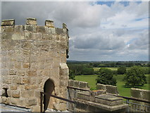NZ0878 : The top of the northeast tower of Belsay Castle and part of the estate by Mike Quinn