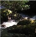 NY2223 : Coledale Beck as it runs through Braithwaite by Iain Lees