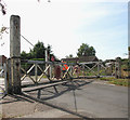 TG3508 : Level crossing on Chapel Road - opening the gates by Evelyn Simak