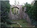 NY1133 : Ruins of the previous church at Bridekirk by John Lord
