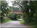 SJ7970 : Low bridge on Bridge Lane by Glyn Drury