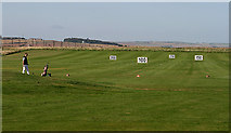 NU0445 : The practice area at Goswick Golf Course by Walter Baxter