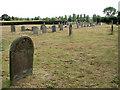 TG3903 : St Botolph's church - churchyard by Evelyn Simak