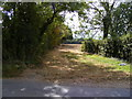 TG0524 : Field Entrance off Reepham Road by Adrian Cable