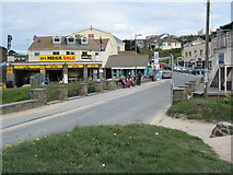 SW9378 : Shops in Polzeath by Philip Halling