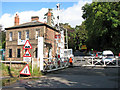 TG3207 : Brundall railway station - level crossing on Station Road by Evelyn Simak