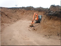 NH6181 : Digger in new quarry for new road by Sarah McGuire