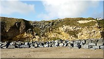 NZ4349 : Magnesian limestone cliffs and sea defences south of Featherbed Rocks by Andrew Curtis