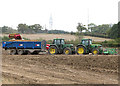 TG2605 : Potato harvest in field north of the A146 by Evelyn Simak