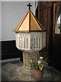TG3419 : St Peter's church - C14 baptismal font by Evelyn Simak
