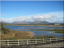 SH5738 : View across Afon Glaslyn to mountains by John Firth