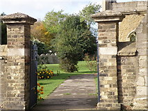 TL2696 : St Andrew's Church gates and Bench Mark by Michael Trolove