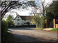 TM1085 : View west along Church Lane towards B1077 by Evelyn Simak
