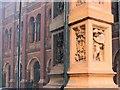 TQ2679 : A window pillar with terracotta figures by Chris Reynolds