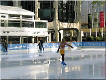 TQ2679 : Reflections in the wet ice on the Open Air Ice Rink by Chris Reynolds