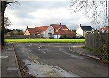 TM1686 : Approaching the village green on School Road by Evelyn Simak