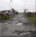 TA0623 : Potholes at the Level Crossing, Barrow Haven by David Wright