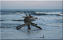 NJ2370 : Damaged Breakwater by Anne Burgess