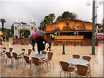 SZ0891 : Bournemouth: man with umbrella in a festive Square by Chris Downer