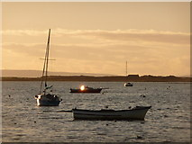 SZ1891 : Mudeford: a boat reflects the Christmas Day sun by Chris Downer