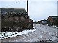 SP8218 : Snowy entrance to Groveway Farm by John Firth