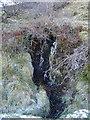 SN7089 : Frozen spring on the side of Moel Fferm by Rudi Winter