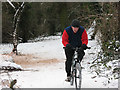 TQ4371 : Mountain biker in the snow by Stephen Craven