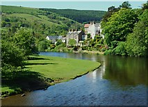 SJ1143 : Riverside Carrog from the river bridge. by John Haynes