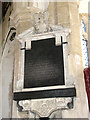 TL7698 : All Saints church - wall monument by chancel arch (close-up) by Evelyn Simak