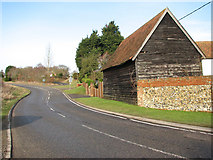 TG1607 : View north along Green Lane by Evelyn Simak