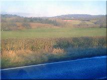 SO7334 : Farmland north of the A417 by Trevor Rickard