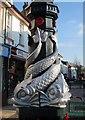 SX9265 : Dolphins on lamp post, St Marychurch by Derek Harper