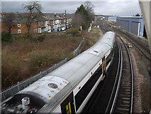 SU4212 : A train shooting Northam Road (A3024) bridge by Stanley Howe