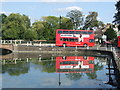 TQ2764 : Bus reflection, Carshalton ponds by Malc McDonald