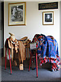 TL9991 : World Horse Welfare headquarters - saddles on display by Evelyn Simak