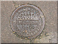 TQ3279 : Coal-hole cover by Stephen Craven
