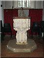 TM1679 : The church of St Leonard in Billingford - baptismal font by Evelyn Simak