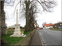 TM1682 : The war memorial in Dickleburgh by Evelyn Simak