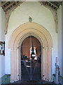 TG0206 : The church of St Peter in Reymerston - north doorway by Evelyn Simak