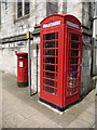 SY6990 : Dorchester: postbox № DT1 80 and phone, High West Street by Chris Downer
