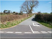 SH5340 : Garnedd-hir lane at its junction with the A487 by Eric Jones