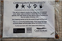 NN6968 : Sign on a mink trap at Loch Cruin by Calum McRoberts
