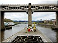 NZ2563 : Wooden jetty that joins the Swing Bridge to High Level Bridge by Andrew Curtis