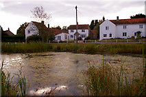 TG0934 : Pond and Cottages, Edgefield, Norfolk by Christine Matthews
