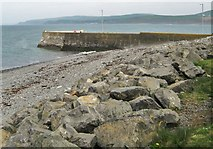 NX3343 : Sea defences near the jetty at Port William by Ann Cook