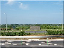 O1069 : View north-eastwards across the M1 south of the Balgeen Toll Plaza by Eric Jones