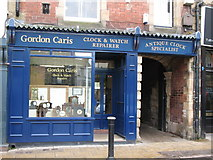 NY9364 : Gordon Caris, Clock &  Watch Repairer, Market Place by Mike Quinn