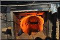 TF9129 : Furnace at Fakenham Gas Works by Ashley Dace